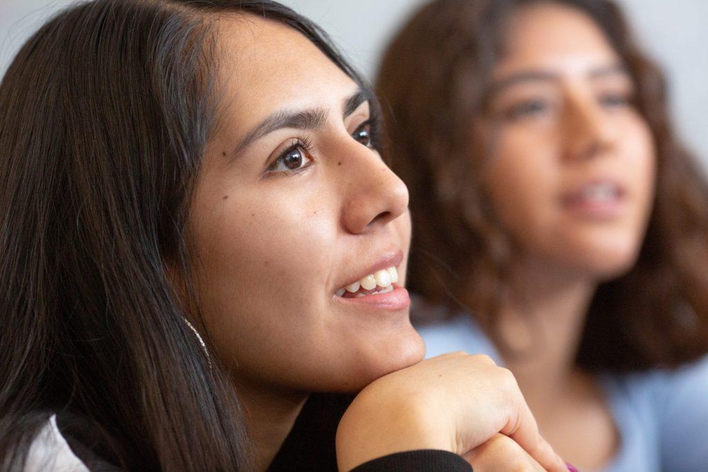 high school student listening during a precalculus class