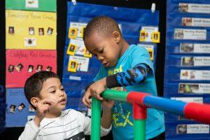 Preschool students building a structure